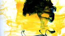 Yellow ink swirling into water whirlpool Footage