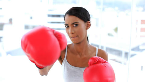 Woman fighting with boxing gloves Footage