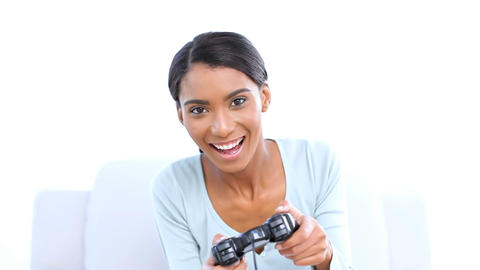 Woman playing and winning at video games Footage