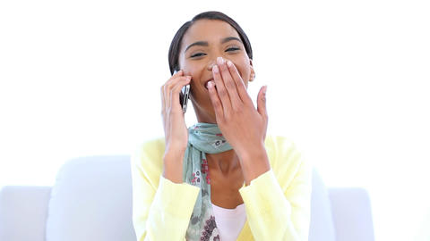 Woman laughing while she is on the phone Footage