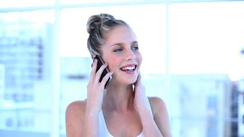 Attractive businesswoman talking on the phone ライブ動画