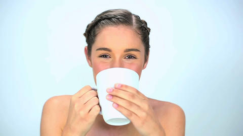 Young woman drinking her cup Footage