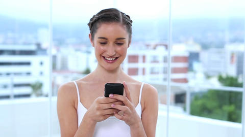 Young woman showing her mobile phone and texting a Footage