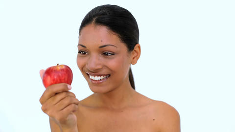 Happy woman showing red apple at camera Footage