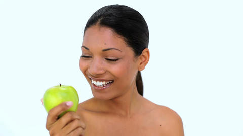 Happy woman showing green apple at camera Footage