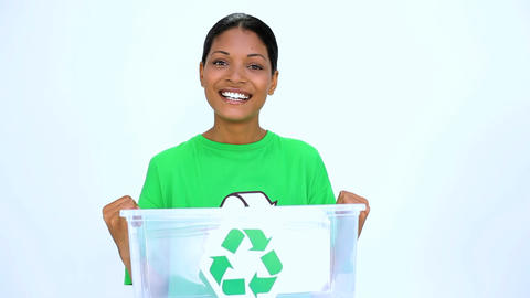 Ecological woman holding recycling bin Footage