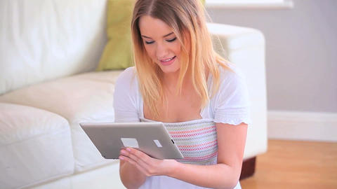 Attractive young blonde using her tablet pc Footage