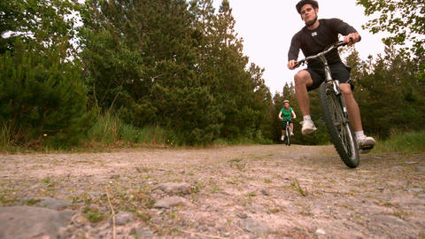 Athletic couple mountain biking in the countryside together Footage