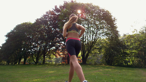 Athletic sporty woman jogging Live Action