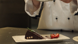 Chef Giving A Cake The Finishing Touch stock footage