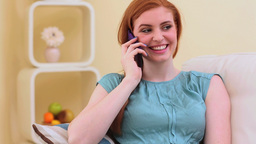 Beautiful brunette dialing a number and phoning Footage