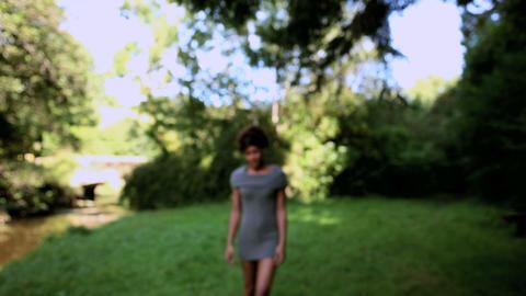 Gorgeous cheerful brunette walking towards camera Footage