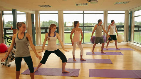 Fitness class and instructor doing yoga exercise Footage