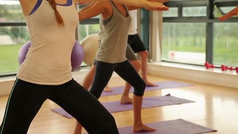 Fitness class and instructor doing pilates exercis Footage