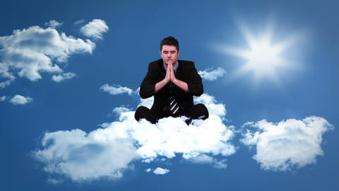 Calm meditating businessman sitting on cloud Animation