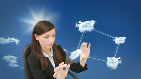 Concentrated young businesswoman doing cloud computing Animation