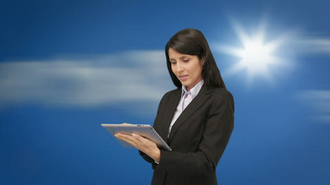 Attractive young businesswoman using her tablet Animation