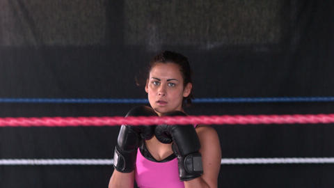Sporty serious brunette boxing Live Action