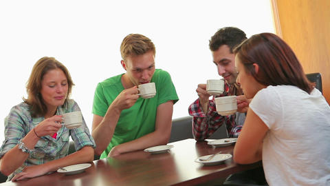 Friends chatting in the canteen over coffee Footage
