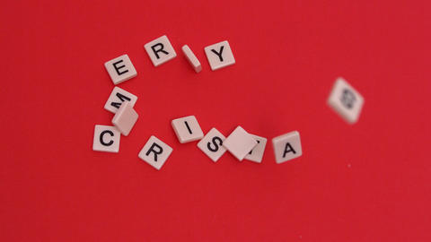 Letter tiles moving to spell merry christmas on red background Live Action