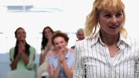 Businesswomen applauding colleague after presentat Footage