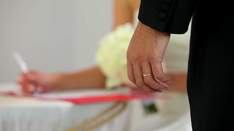 Bride signing the wedding register Footage