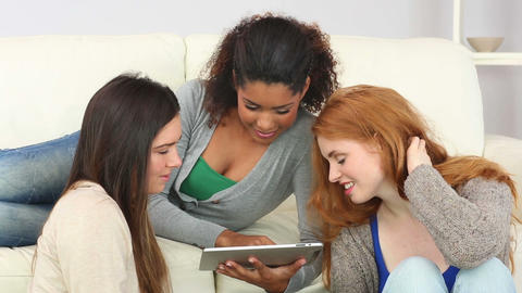 Woman showing her tablet to her friends Footage