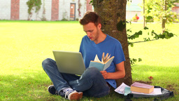 Focused student studying outside Footage