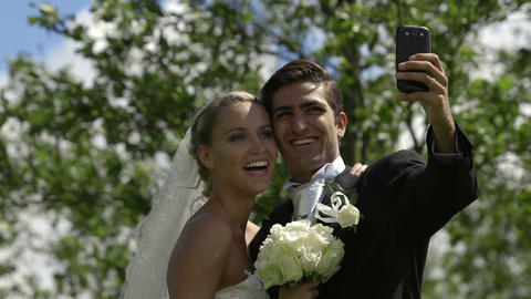 Bride and groom taking a selfie outside Footage
