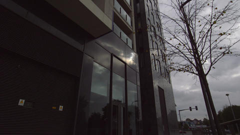 Low angle shot of a large grey office building Footage