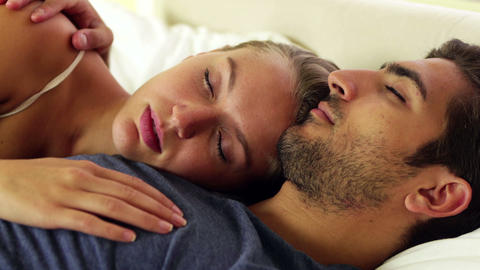 Cute couple sleeping and cuddling in bed Live Action