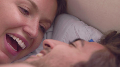 Intimate couple speaking in bed Footage