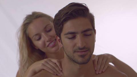 Blonde giving her boyfriend a shoulder rub Live Action