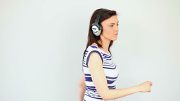 Dancing brunette listening to music Footage