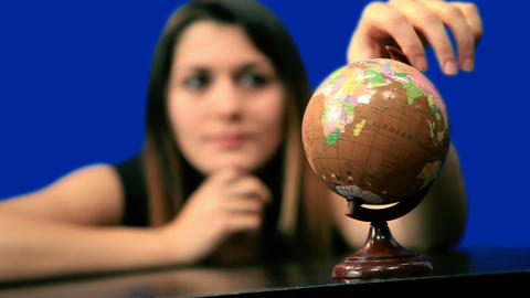 Blue screen beautiful girl hold globe sit table Footage