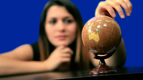 Blue screen beautiful girl hold globe sit table Stock Video Footage