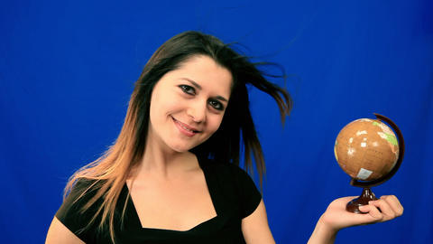 Blue screen beautiful girl hold globe windy hair Stock Video Footage