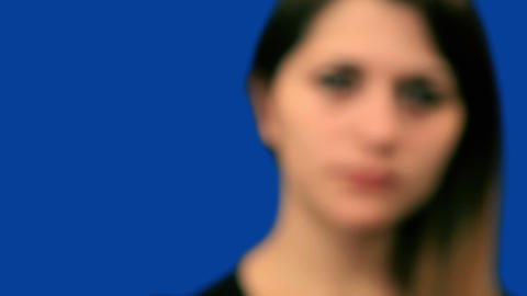 Blue screen beautiful girl try to hear close up Stock Video Footage