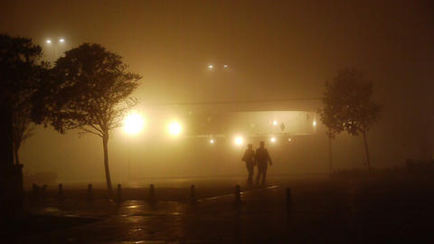 Romantic couple walking on a foggy night Footage