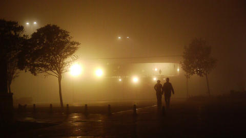 Romantic couple walking on a foggy night Stock Video Footage