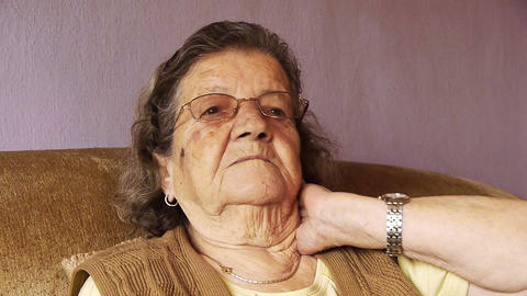 Senior old woman health pain neck rheumatism Stock Video Footage