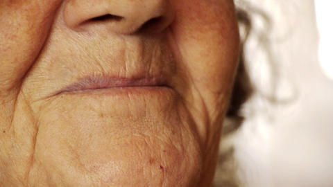 Senior old woman smile mouth wrinkle skin close up Stock Video Footage