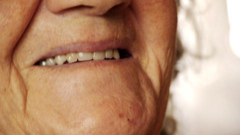 Senior old woman smile mouth wrinkle skin close up Footage