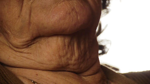Senior old woman throat neck wrinkle skin close up 2 Footage