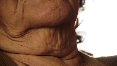 Senior old woman throat neck wrinkle skin close up 2 Stock Video Footage