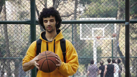 Young man play basketball ball turn on finger streetball... Stock Video Footage