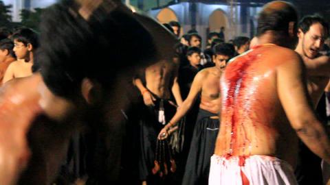Ritualistic Self Flagellation at Ashura Festival in Karachi, Pakistan Footage