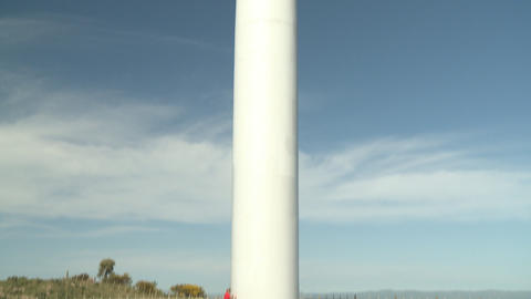 Wind turbine tilt up shot Footage