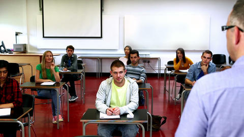 Lecturer speaking to his class Footage
