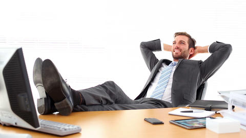 Relaxed businessman putting his feet up Footage